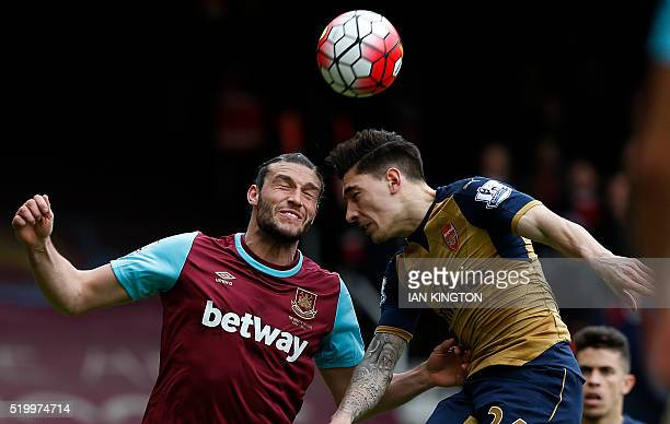 West Ham United's English striker Andy Carroll vies in the air with Arsenal's Spanish defender Hector Bellerin during the English Premier League...