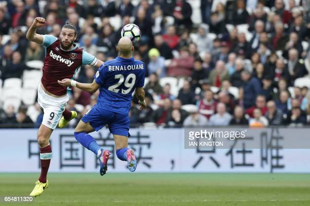 West Ham United's English striker Andy Carroll vies with Leicester City's French defender Yohan Benalouane during the English Premier League football...