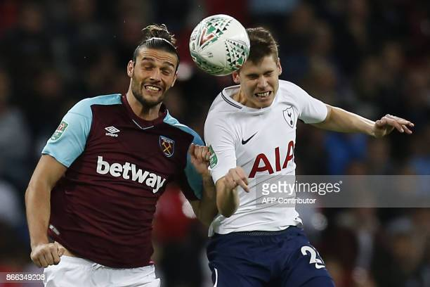 West Ham United's English striker Andy Carroll vuies with Tottenham Hotspur's Argentinian defender Juan Foyth during the English League Cup fourth...