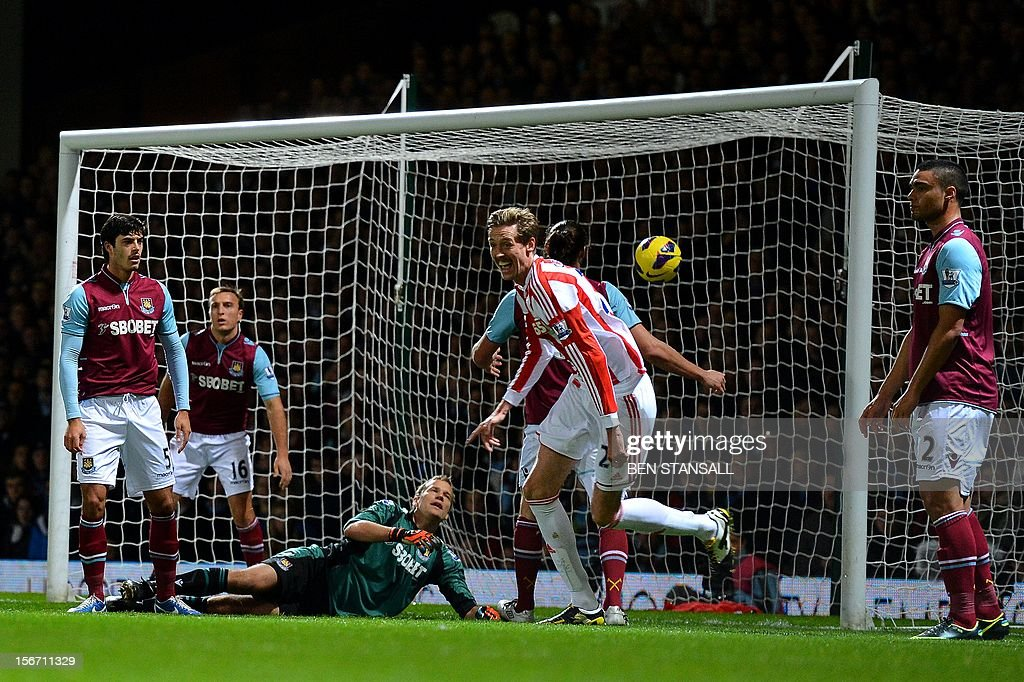 "West Ham United's Finnish goalkeeper Juss Jaaskelainen (C) looks on as Stoke City's English forward Peter Crouch (2nd R) reacts following a goal by Stoke City's Irish forward Jon Walters (not seen) during the English Premier League football match between West Ham and Stoke City at the Boleyn Ground, Upton Park, in East London, England, on November 19, 2012. USE. No use with unauthorized audio, video, data, fixture lists, club/league logos or ""live"" services. Online in-match use limited to 45 images, no video emulation. No use in betting, games or single club/league/player publications."