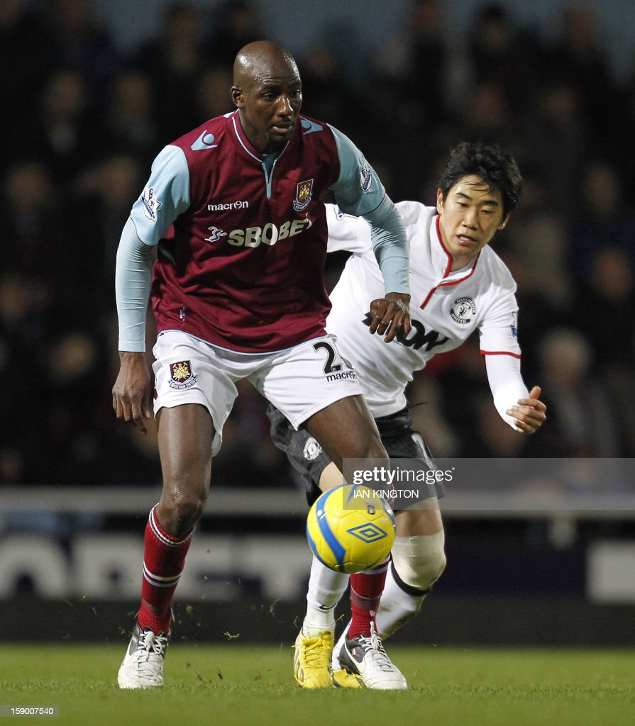 "West Ham United's French midfielder Alou Diarra (L) vies with Manchester United's Japanese midfielder Shinji Kagawa (R) during the English FA Cup third round football match between West Ham United and Manchester United at the Boleyn Ground, Upton Park, in East London on January 5, 2013. The game finished 2-2. USE. No use with unauthorized audio, video, data, fixture lists, club/league logos or ""live"" services. Online in-match use limited to 45 images, no video emulation. No use in betting, games or single club/league/player publications."