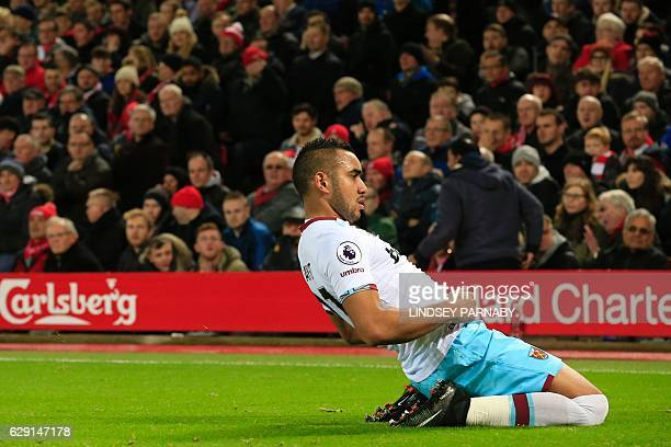 West Ham United's French midfielder Dimitri Payet celebrates after scoring their first goal during the English Premier League football match between...