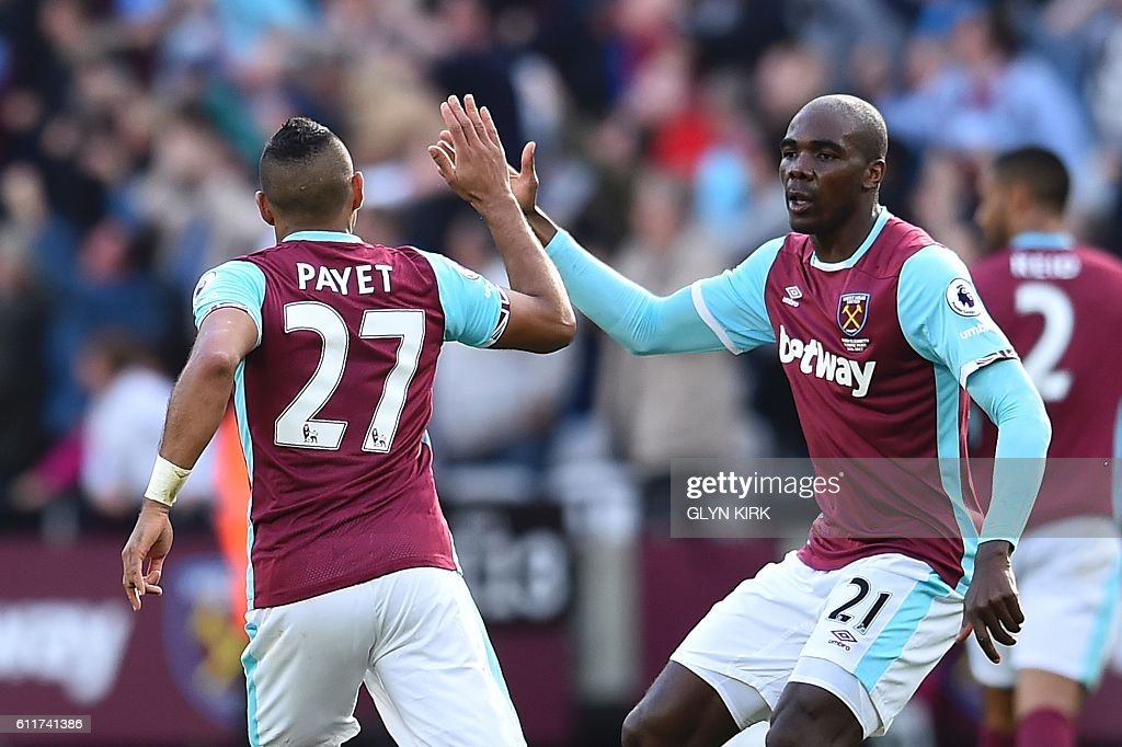 West Ham United's French midfielder Dimitri Payet (L) high-fives West Ham United's Italian defender Angelo Ogbonna (R) after scoring their first goal to equalise 1-1 during the English Premier League football match between West Ham United and Middlesbrough at The London Stadium, in east London on October 1, 2016. / AFP / GLYN KIRK / RESTRICTED TO EDITORIAL USE. No use with unauthorized audio, video, data, fixture lists, club/league logos or 'live' services. Online in-match use limited to 75 images, no video emulation. No use in betting, games or single club/league/player publications. /