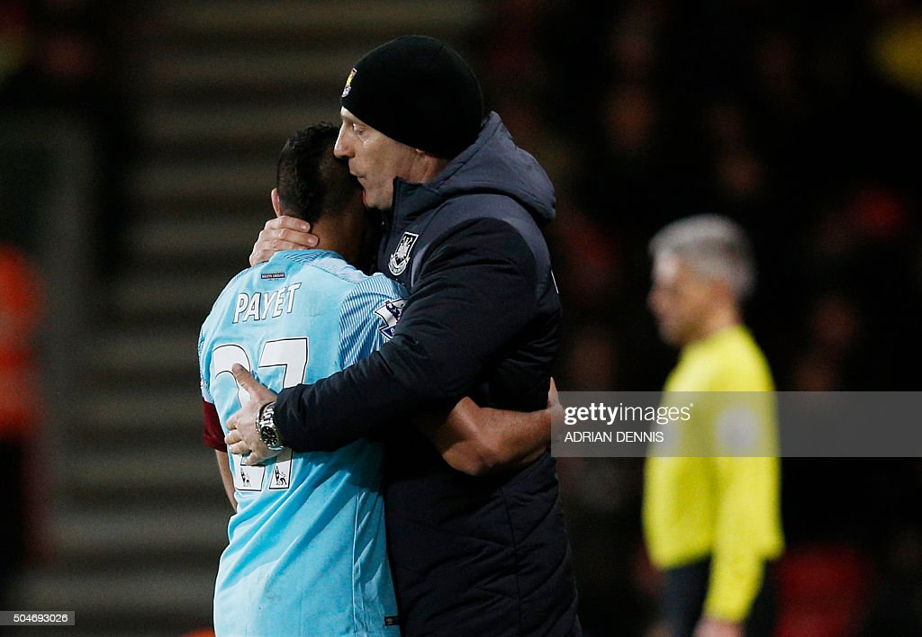 West Ham United's French midfielder Dimitri Payet (L) is embraced by West Ham United's Croatian manager Slaven Bilic during the English Premier League football match between Bournemouth and West Ham United at the Vitality Stadium in Bournemouth, southern England on January 12, 2016. AFP PHOTO / ADRIAN DENNIS USE. No use with unauthorized audio, video, data, fixture lists, club/league logos or 'live' services. Online in-match use limited to 75 images, no video emulation. No use in betting, games or single club/league/player publications. / AFP / ADRIAN