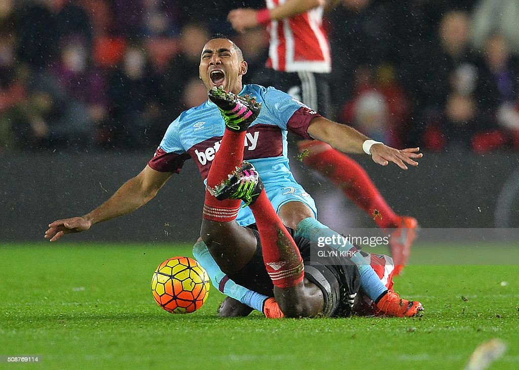 West Ham United's French midfielder Dimitri Payet (L) reacts as he is tackled by Southampton's Kenyan midfielder Victor Wanyama during the English Premier League football match between Southampton and West Ham United at St Mary's Stadium in Southampton, southern England on February 6, 2016. Wanyama was shown the red card for the challenge. / AFP / GLYN KIRK / RESTRICTED TO EDITORIAL USE. No use with unauthorized audio, video, data, fixture lists, club/league logos or 'live' services. Online in-match use limited to 75 images, no video emulation. No use in betting, games or single club/league/player publications. /