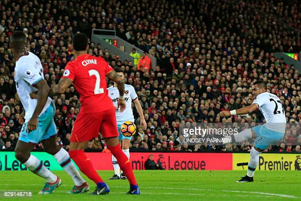 West Ham United's French midfielder Dimitri Payet scores from a freekick to make the score 11 during the English Premier League football match...