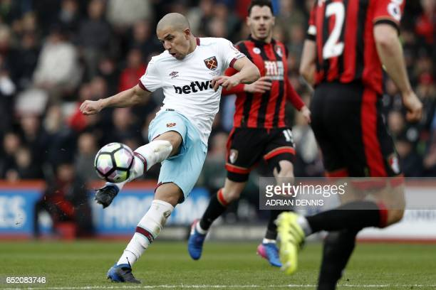 West Ham United's Frenchborn Algerian midfielder Sofiane Feghouli has an unsuccessful shot during the English Premier League football match between...