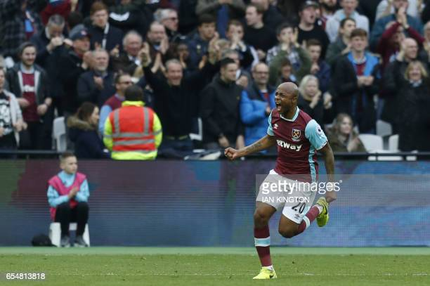 West Ham United's Frenchborn Ghanaian midfielder Andre Ayew celebrates after scoring during the English Premier League football match between West...
