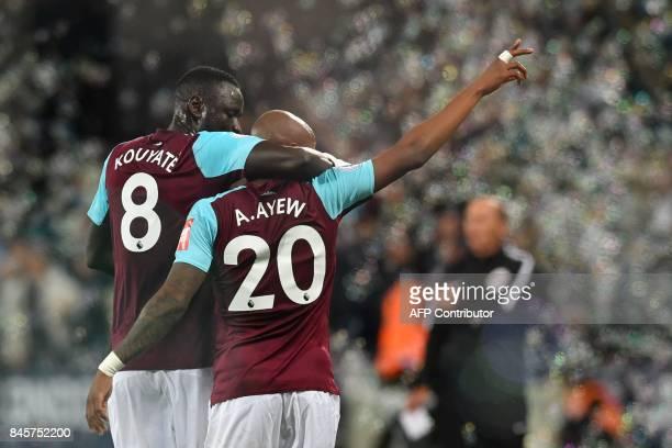 West Ham United's Frenchborn Ghanaian midfielder Andre Ayew celebrates with West Ham United's Senegalese midfielder Cheikhou Kouyate after scoring...