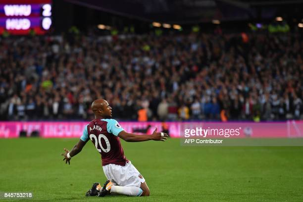 West Ham United's Frenchborn Ghanaian midfielder Andre Ayew celebrates after scoring their second goal during the English Premier League football...