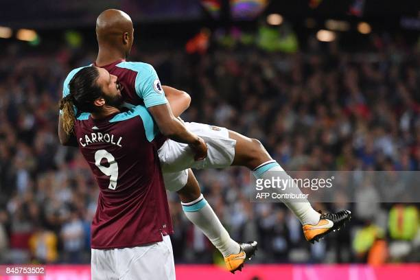 West Ham United's Frenchborn Ghanaian midfielder Andre Ayew celebrates wtih West Ham United's English striker Andy Carroll after scoring their second...