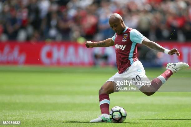 West Ham United's Frenchborn Ghanaian midfielder Andre Ayew plays the ball during the English Premier League football match between West Ham United...