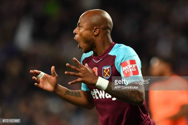 West Ham United's Frenchborn Ghanaian midfielder Andre Ayew reacts during the English Premier League football match between West Ham United and...