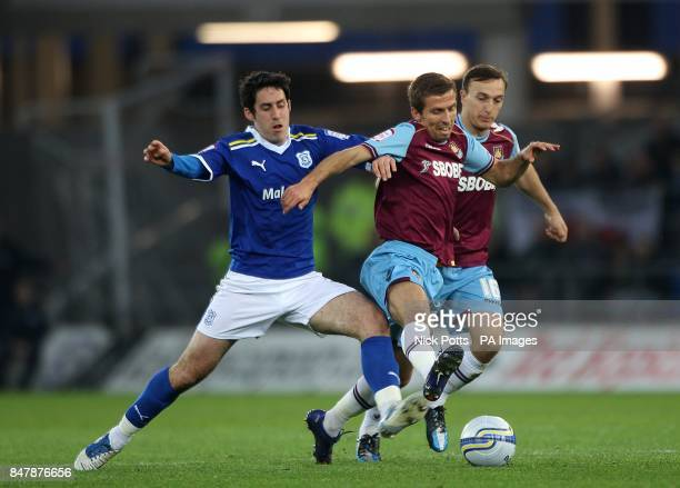 West Ham United's Gary O'Neil and Cardiff City's Peter Whittingham battle for the ball