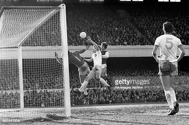 West Ham United's goalkeeper Mervyn Day and defender Kevin Lock thwart Arsenal's Malcolm MacDonald's attempt on goal during an attack