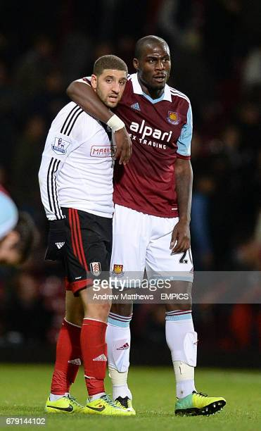 West Ham United's Guy Demel and Fulham's Adel Taarabt after the final whistle