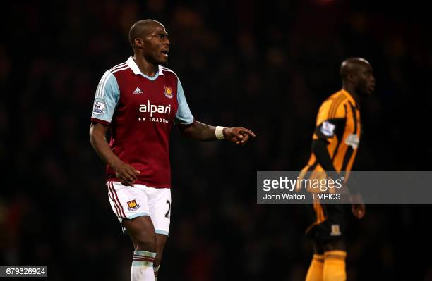 West Ham United's Guy Demel and Hull City's Yannick Sagbo