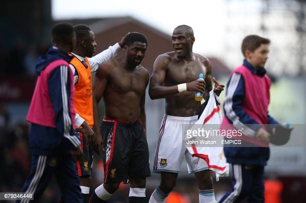 West Ham United's Guy Demel and Liverpool's Kolo Toure walk off the pitch after the match