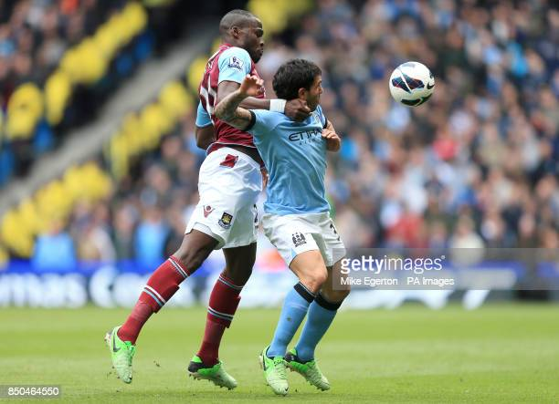 West Ham United's Guy Demel and Manchester City's Carlos Tevez in action