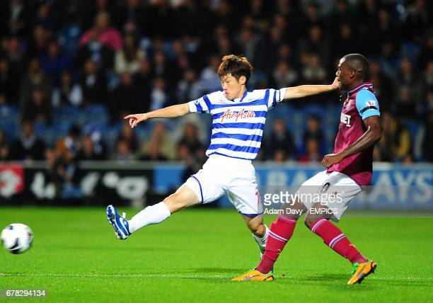 West Ham United's Guy Demel and Queens Park Rangers' JiSung Park battle for the ball