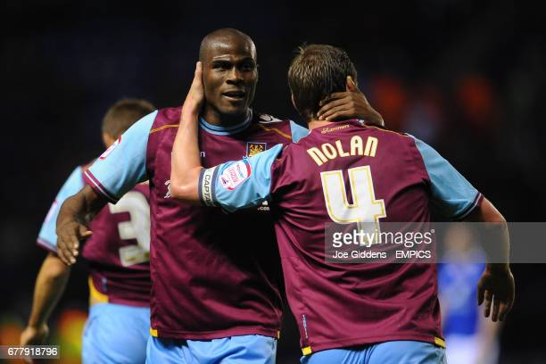 West Ham United's Guy Demel celebrates with Kevin Nolan
