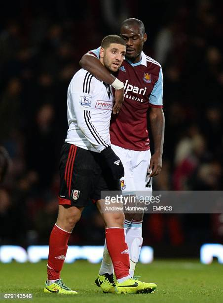 West Ham United's Guy Demel consoles Fulham's Adel Taarabt after the final whistle