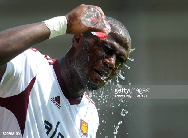 West Ham United's Guy Demel cools himself down with some water