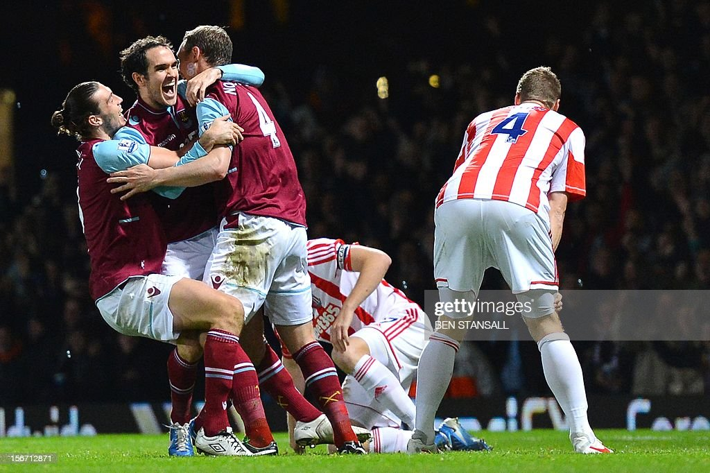"West Ham United's Irish defender Joey O'Brien (2nd L) celebrates after scoring a goal during the English Premier League football match between West Ham and Stoke City at the Boleyn Ground, Upton Park, in East London, England, on November 19, 2012. USE. No use with unauthorized audio, video, data, fixture lists, club/league logos or ""live"" services. Online in-match use limited to 45 images, no video emulation. No use in betting, games or single club/league/player publications."