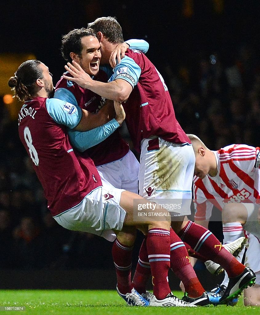 """West Ham United's Irish defender Joey O'Brien (C) celebrates after scoring a goal during the English Premier League football match between West Ham and Stoke City at the Boleyn Ground, Upton Park, in East London, England, on November 19, 2012. USE. No use with unauthorized audio, video, data, fixture lists, club/league logos or """"live"""" services. Online in-match use limited to 45 images, no video emulation. No use in betting, games or single club/league/player publications."""