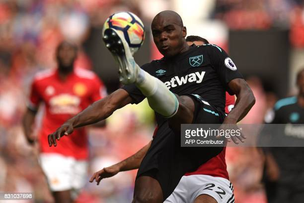 West Ham United's Italian defender Angelo Ogbonna clears the ball during the English Premier League football match between Manchester United and West...