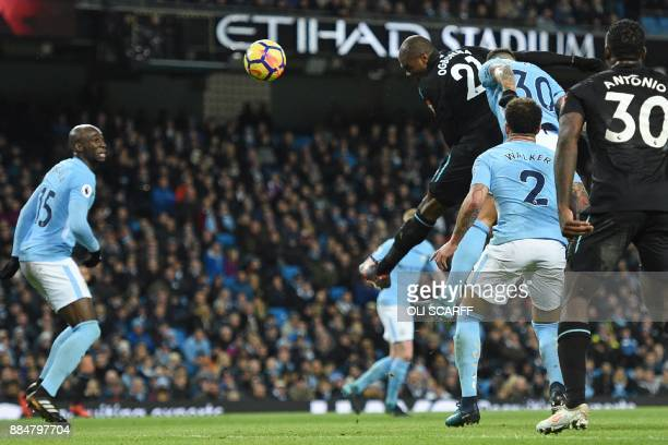 West Ham United's Italian defender Angelo Ogbonna heads the ball to score the opening goal during the English Premier League football match between...