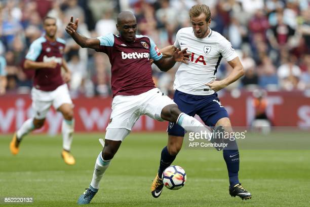 West Ham United's Italian defender Angelo Ogbonna vies with Tottenham Hotspur's English striker Harry Kane during the English Premier League football...
