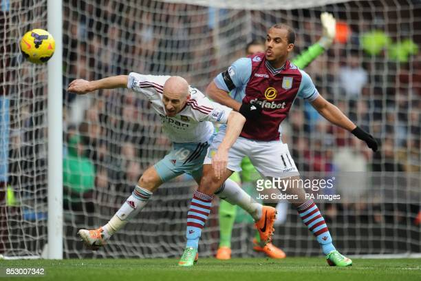 West Ham United's James Collins and Aston Villa's Gabriel Agbonlahor battle for the ball during the Barclays Premier League match at Villa Park...