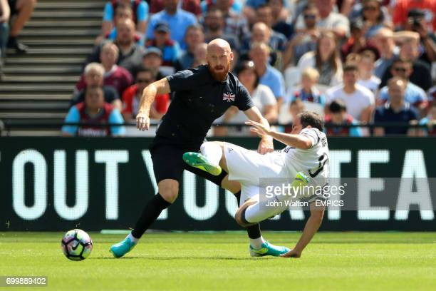 West Ham United's James Collins and Juventus' Gonzalo Higuain battle for the ball
