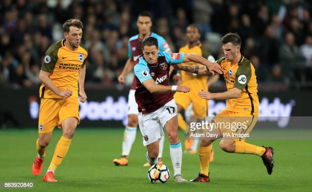 West Ham United's Javier Hernandez and Brighton Hove Albion's Pascal Gross battle for the ball during the Premier League match at the London Stadium
