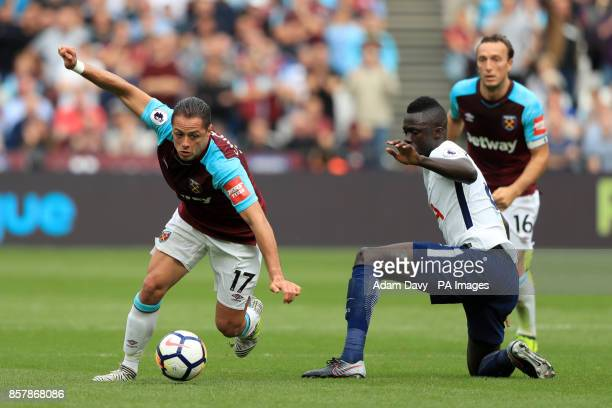 West Ham United's Javier Hernandez and Tottenham Hotspur's Davinson Sanchez battle for the ball