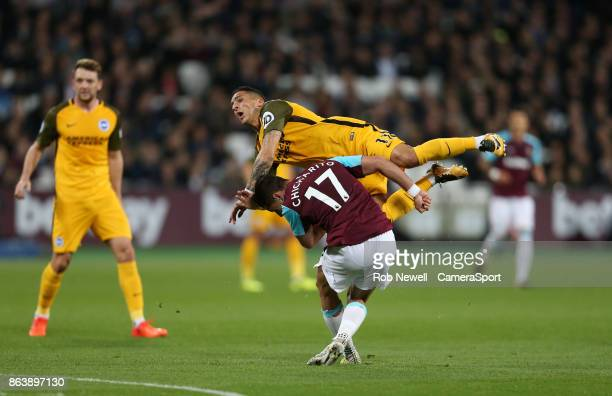 West Ham United's Javier Hernandez clashes with Brighton Hove Albion's Anthony Knockaert during the Premier League match between West Ham United and...