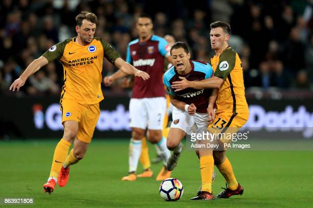 West Ham United's Javier Hernandez takes on Brighton Hove Albion's Pascal Gross and Dale Stephens during the Premier League match at the London...