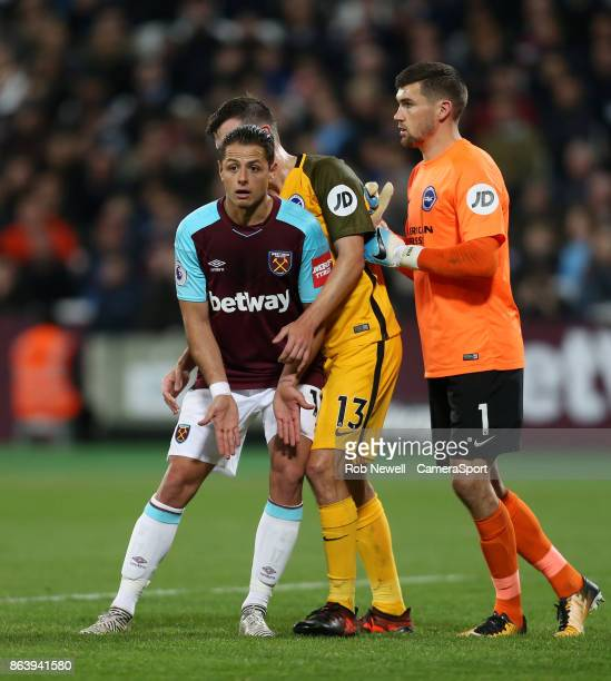 West Ham United's Javier Hernandez with Brighton Hove Albion's Pascal Groß and Matthew Ryan during the Premier League match between West Ham United...