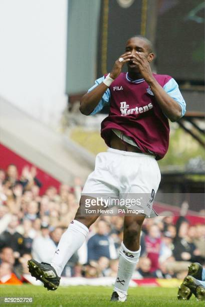 West Ham United's Jermain Defoe reacts after missing a goal oppertunity against Aston Villa during their FA Barclaycard Premiership match at West...