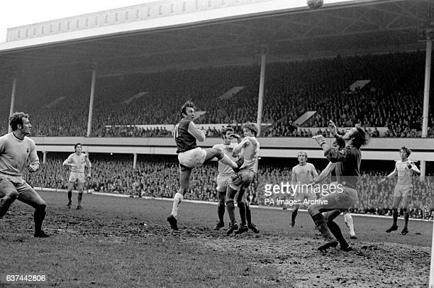West Ham United's Jimmy Greaves tries to loop a header over Coventry City goalkeeper Bill Glazier