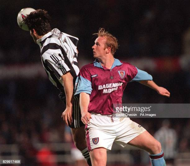 West Ham United's John Hartson is beaten to the ball by Newcastle United's Philippe Albert during tonight's FA Premiership title deciding match at...