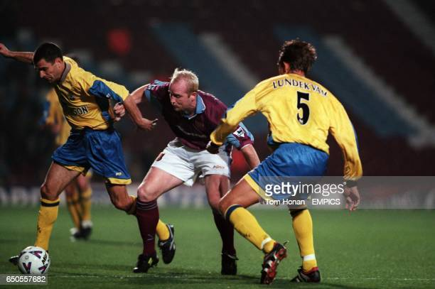 West Ham United's John Hartson is outfought by Southampton's Francis Benali and Claus Lundekvam
