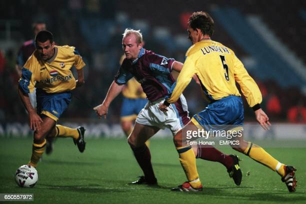 West Ham United's John Hartson takes on Southampton's Francis Benali and Claus Lundekvam