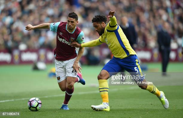 West Ham United's Jonathan Calleri and Everton's Ashley Williams battle for the ball during the Premier League match at London Stadium