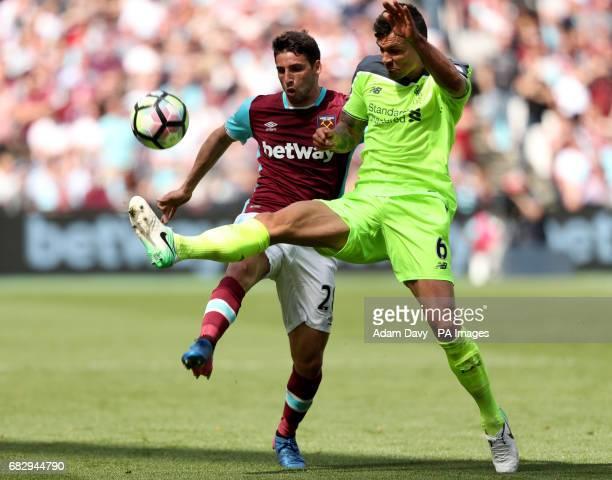 West Ham United's Jonathan Calleri and Liverpool's Dejan Lovren battle for the ball during the Premier League match at London Stadium