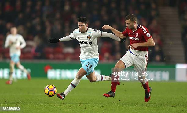 West Ham United's Jonathan Calleri and Middlesbrough's Ben Gibson during the Premier League match between Middlesbrough and West Ham United at...
