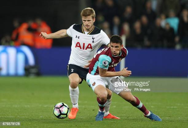 West Ham United's Jonathan Calleri and Tottenham Hotspur's Eric Dier battle for the ball during the Premier League match at The London Stadium London