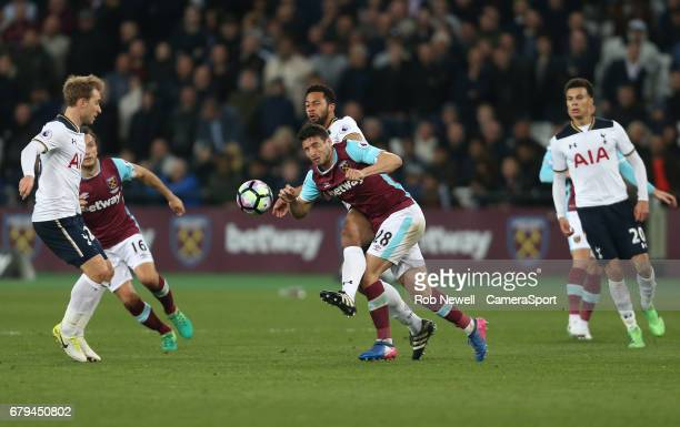 West Ham United's Jonathan Calleri and Tottenham Hotspur's Mousa Dembele during the Premier League match between West Ham United and Tottenham...