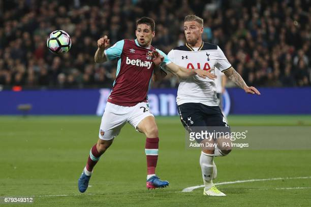 West Ham United's Jonathan Calleri and Tottenham Hotspur's Toby Alderweireld battle for the ball during the Premier League match at The London...